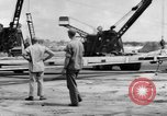 Image of B-29 lifted at North Field Guam, 1945, second 55 stock footage video 65675041657