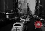 Image of crowded Fifth Avenue New York  New York City USA, 1946, second 42 stock footage video 65675041739