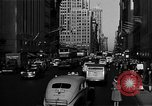 Image of crowded Fifth Avenue New York  New York City USA, 1946, second 55 stock footage video 65675041739