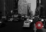 Image of crowded Fifth Avenue New York  New York City USA, 1946, second 57 stock footage video 65675041739