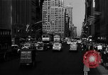 Image of crowded Fifth Avenue New York  New York City USA, 1946, second 62 stock footage video 65675041739