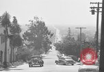 Image of La Cienega Blvd, City Hall, and Hollywood Memorial Park Cemetery Los Angeles California USA, 1950, second 25 stock footage video 65675041957