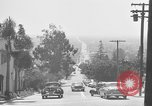 Image of La Cienega Blvd, City Hall, and Hollywood Memorial Park Cemetery Los Angeles California USA, 1950, second 27 stock footage video 65675041957