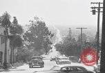 Image of La Cienega Blvd, City Hall, and Hollywood Memorial Park Cemetery Los Angeles California USA, 1950, second 29 stock footage video 65675041957