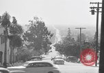 Image of La Cienega Blvd, City Hall, and Hollywood Memorial Park Cemetery Los Angeles California USA, 1950, second 30 stock footage video 65675041957