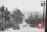 Image of La Cienega Blvd, City Hall, and Hollywood Memorial Park Cemetery Los Angeles California USA, 1950, second 33 stock footage video 65675041957