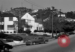 Image of La Cienega Blvd, City Hall, and Hollywood Memorial Park Cemetery Los Angeles California USA, 1950, second 45 stock footage video 65675041957