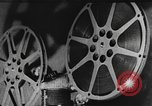 Image of how motion picture projectors, cameras, and optical sound works United States USA, 1939, second 2 stock footage video 65675041965