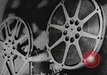 Image of how motion picture projectors, cameras, and optical sound works United States USA, 1939, second 4 stock footage video 65675041965