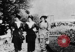 Image of Three women strolling in a park Paris France, 1907, second 5 stock footage video 65675042050