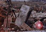 Image of collapsed metal stack Nagasaki Japan, 1946, second 52 stock footage video 65675042187