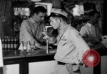 Image of Schepps Beer offered at special price of 60 cents an hour Dallas Texas United States USA, 1935, second 16 stock footage video 65675042250