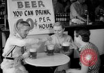 Image of Schepps Beer offered at special price of 60 cents an hour Dallas Texas United States USA, 1935, second 27 stock footage video 65675042250