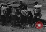 Image of house on fire China, 1945, second 27 stock footage video 65675042297