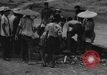 Image of house on fire China, 1945, second 28 stock footage video 65675042297