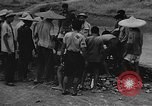 Image of house on fire China, 1945, second 29 stock footage video 65675042297