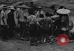 Image of house on fire China, 1945, second 30 stock footage video 65675042297