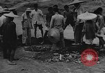 Image of house on fire China, 1945, second 31 stock footage video 65675042297
