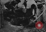Image of house on fire China, 1945, second 36 stock footage video 65675042297