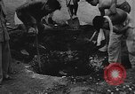 Image of house on fire China, 1945, second 37 stock footage video 65675042297