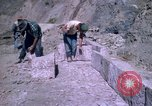Image of pick axe Bolivia, 1966, second 42 stock footage video 65675042327