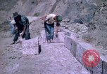 Image of pick axe Bolivia, 1966, second 43 stock footage video 65675042327