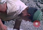 Image of pick axe Bolivia, 1966, second 50 stock footage video 65675042327
