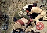Image of construction of a road Bolivia, 1966, second 31 stock footage video 65675042328