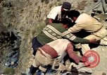 Image of construction of a road Bolivia, 1966, second 32 stock footage video 65675042328