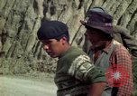 Image of construction of a road Bolivia, 1966, second 42 stock footage video 65675042328