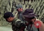 Image of construction of a road Bolivia, 1966, second 46 stock footage video 65675042328