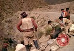 Image of construction of a road Bolivia, 1966, second 58 stock footage video 65675042328
