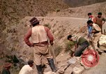 Image of construction of a road Bolivia, 1966, second 59 stock footage video 65675042328