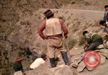 Image of construction of a road Bolivia, 1966, second 61 stock footage video 65675042328