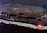 Image of Variety of  U.S. Navy aircraft landing on the USS Forrestal at sea Atlantic Ocean, 1959, second 12 stock footage video 65675042344