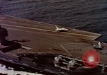 Image of Variety of  U.S. Navy aircraft landing on the USS Forrestal at sea Atlantic Ocean, 1959, second 23 stock footage video 65675042344