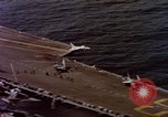 Image of Variety of  U.S. Navy aircraft landing on the USS Forrestal at sea Atlantic Ocean, 1959, second 24 stock footage video 65675042344