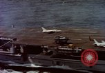 Image of Variety of  U.S. Navy aircraft landing on the USS Forrestal at sea Atlantic Ocean, 1959, second 30 stock footage video 65675042344