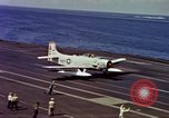 Image of Variety of  U.S. Navy aircraft landing on the USS Forrestal at sea Atlantic Ocean, 1959, second 44 stock footage video 65675042344