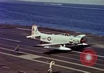 Image of Variety of  U.S. Navy aircraft landing on the USS Forrestal at sea Atlantic Ocean, 1959, second 45 stock footage video 65675042344