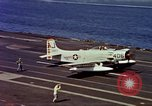 Image of Variety of  U.S. Navy aircraft landing on the USS Forrestal at sea Atlantic Ocean, 1959, second 46 stock footage video 65675042344