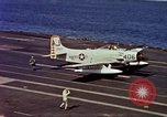 Image of Variety of  U.S. Navy aircraft landing on the USS Forrestal at sea Atlantic Ocean, 1959, second 47 stock footage video 65675042344