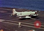 Image of Variety of  U.S. Navy aircraft landing on the USS Forrestal at sea Atlantic Ocean, 1959, second 48 stock footage video 65675042344