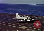 Image of Variety of  U.S. Navy aircraft landing on the USS Forrestal at sea Atlantic Ocean, 1959, second 57 stock footage video 65675042344