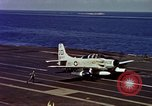 Image of Variety of  U.S. Navy aircraft landing on the USS Forrestal at sea Atlantic Ocean, 1959, second 58 stock footage video 65675042344