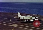 Image of Variety of  U.S. Navy aircraft landing on the USS Forrestal at sea Atlantic Ocean, 1959, second 59 stock footage video 65675042344