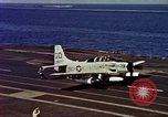 Image of Variety of  U.S. Navy aircraft landing on the USS Forrestal at sea Atlantic Ocean, 1959, second 61 stock footage video 65675042344