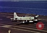 Image of Variety of  U.S. Navy aircraft landing on the USS Forrestal at sea Atlantic Ocean, 1959, second 62 stock footage video 65675042344