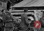 Image of WWI American soldiers at a funeral France, 1918, second 49 stock footage video 65675042397