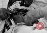 Image of abdominal wound surgery on World War 1 soldier France, 1918, second 24 stock footage video 65675042421